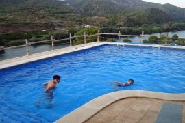 El Figueral Kids in the pool with a view